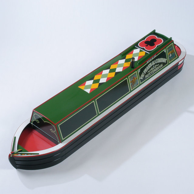 A coffin in the shape of a barge boat. (Photo by Caters News Agency)