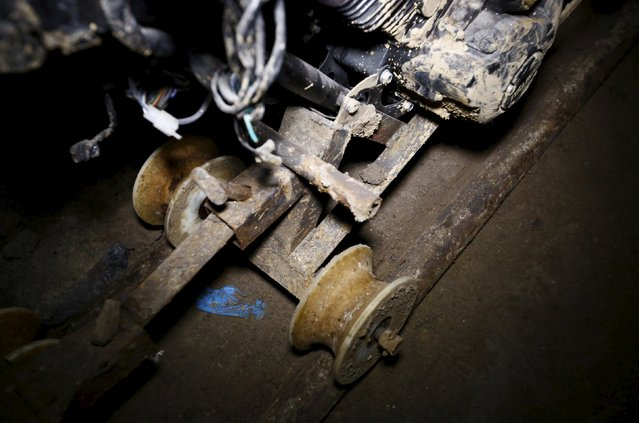 "Part of a motorcycle modified to run on rails is seen inside a tunnel connected to the Altiplano Federal Penitentiary and used by drug lord Joaquin ""El Chapo"" Guzman to escape, in Almoloya de Juarez, on the outskirts of Mexico City, July 15, 2015. (Photo by Edgard Garrido/Reuters)"