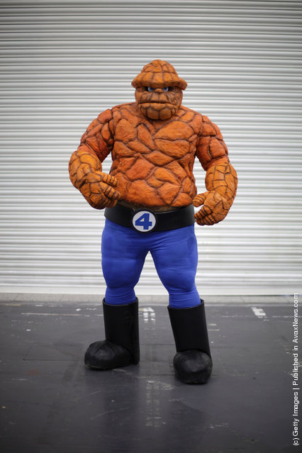 A visitor to the London Super Comic Convention dresses as 'The Thing' at ExCel