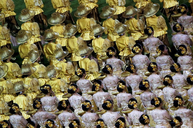 Thai dancers perform during a Holy Mass celebrated by Pope Francis at National Stadium in Bangkok, Thailand, 21 November 2019. Pope Francis is in Thailand for an apostolic visit on the occasion of the 350th anniversary of the founding of Mission de Siam. Pope Francis is the first pontiff to visit Thailand in nearly four decades after John Paul II in 1984. (Photo by Diego Azubel/EPA/EFE)