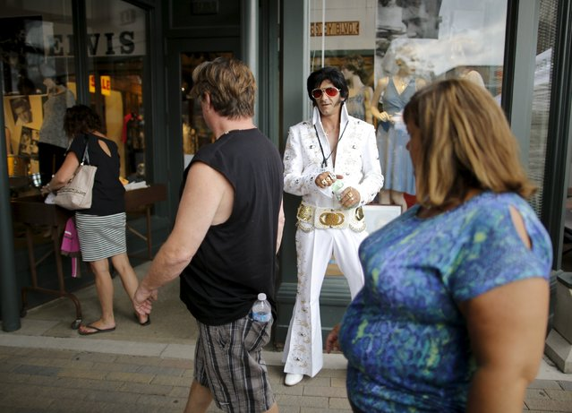 Elvis Presley tribute artist Dave Hodgins of Angus, Ontario greets visitors during the four-day Collingwood Elvis Festival in Collingwood, Ontario July 25, 2015. (Photo by Chris Helgren/Reuters)