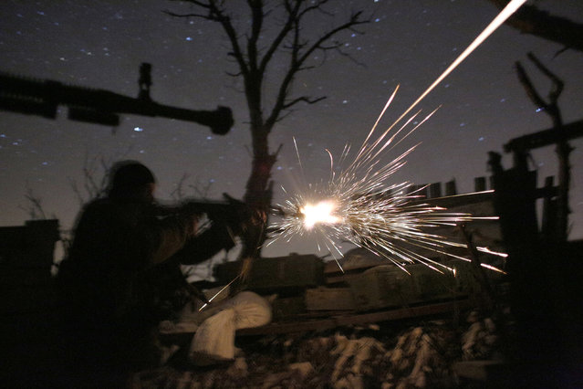 """Ukrainian servicemen shot with machine guns during fighting with pro-Russian separatists in Avdiivka, Donetsk region on March 31, 2017. US Secretary of State Rex Tillerson pressed NATO allies on March 31, 2017 to ramp up military spending and denounced Russia's """"aggression"""" in Ukraine, toughening the Trump administration's tone toward Moscow. (Photo by Anatolii Stepanov/AFP Photo)"""