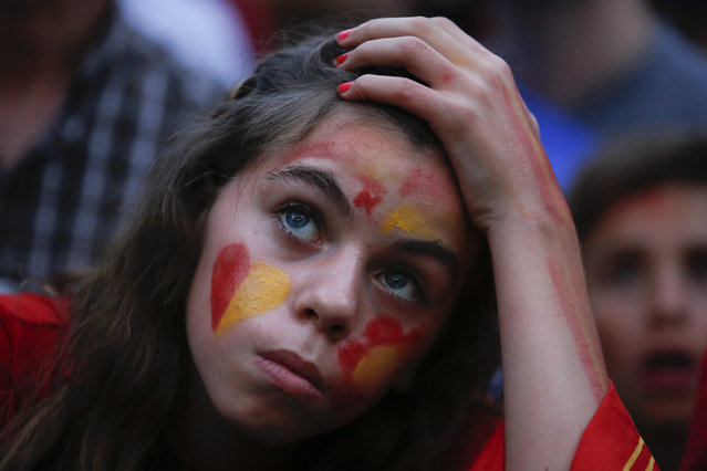 A Spain supporter reacts as she watches the team's 2014 World Cup Group B soccer match against Netherlands on a giant screen at a fan park in Madrid, June 13, 2014. (Photo by Juan Medina/Reuters)