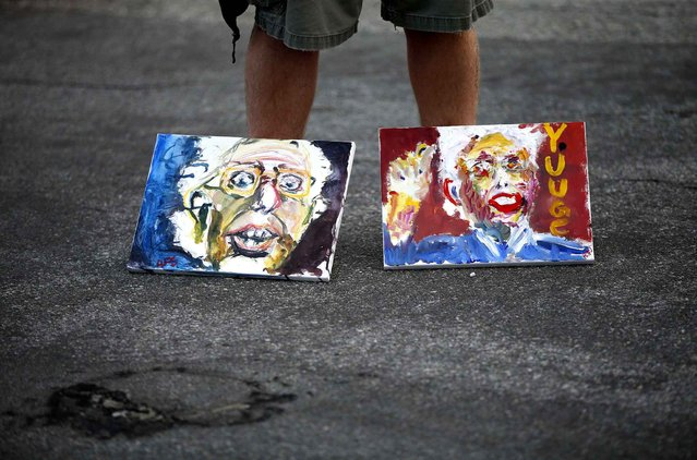 A man stands with paintings of Democratic presidential candidate Sen. Bernie Sanders, I-Vt., before a rally Tuesday, June 7, 2016, in Santa Monica, Calif. (Photo by John Locher/AP Photo)