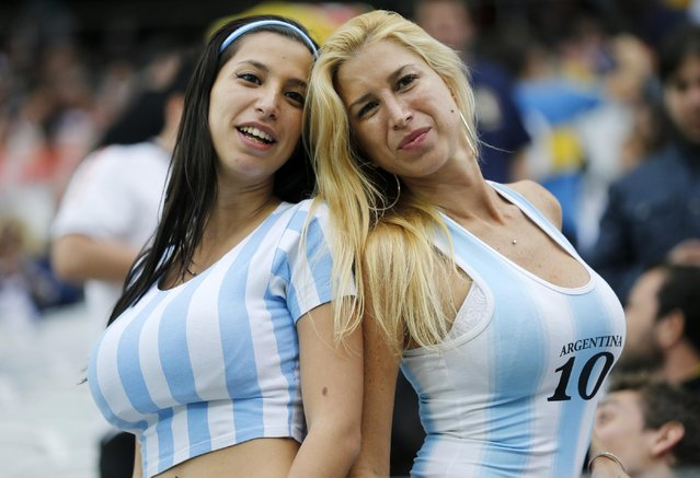 Argentina supporters pose for a photograph prior to the World Cup semifinal soccer match between the Netherlands and Argentina at the Itaquerao Stadium in Sao Paulo, Brazil, Wednesday, July 9, 2014. (Photo by Frank Augstein/AP Photo)