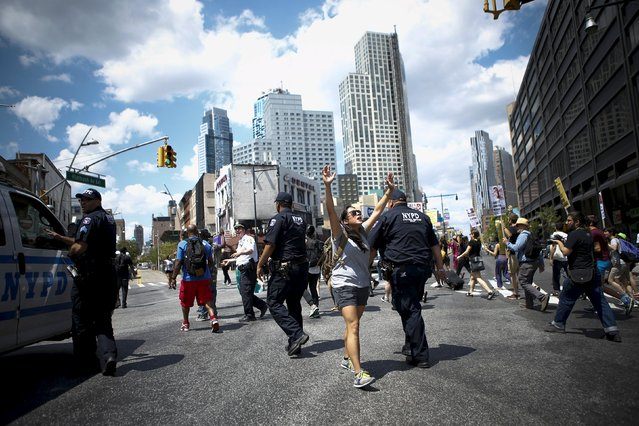 Protesters march through Brooklyn streets after holding a rally at Barclays Center marking the first anniversary of the death of Michael Brown, in Brooklyn, New York August 9, 2015. (Photo by Eduardo Munoz/Reuters)