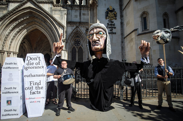 Supporters from the group Distant Voices, who oppose the liberalisation of euthanasia laws, demonstrate with a giant puppet of a judge outside the Royal Courts of Justice, Strand on July 17, 2017 in London, England. Noel Conway, 67, who is terminally ill with motor neurone disease, is seeking a legal challenge on the law banning assisted dying. (Photo by Jack Taylor/Getty Images)