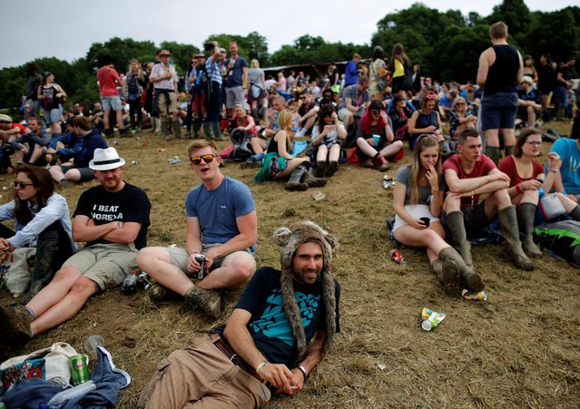 Revellers rest in a field during the Glastonbury Festival at Worthy Farm in Somerset, Britain, June 23, 2016. (Photo by Stoyan Nenov/Reuters)