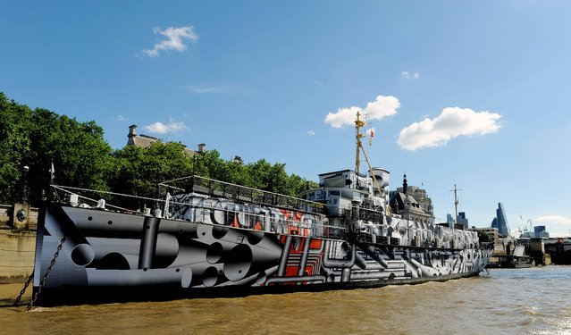 The WWI warship HMS President (1918) which has become a public art work on London's Embankment, called Dazzle Ship London by artist Tobias Rehberger, the ship, one of the last surviving three WWI warships, has been covered in dazzle camouflage print as part of 14 – 18 Now, a programme of events to mark the centenary of World War I. (Photo by Nick Ansell/PA Wire)