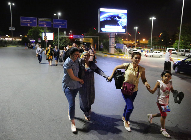 People walk away from Istanbul Ataturk airport, Turkey, following a blast June 28, 2016. (Photo by Goran Tomasevic/Reuters)
