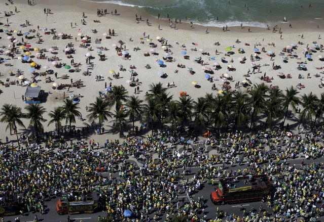 Demonstrators attend a protest against Brazil's President Dilma Rousseff, part of nationwide protests calling for her impeachment, in Copacabana in Rio de Janeiro, Brazil August 16, 2015. (Photo by Ricardo Moraes/Reuters)
