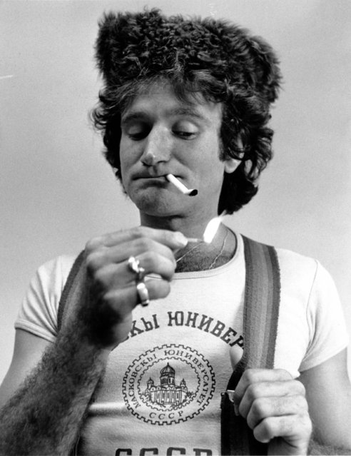 """Comedian Robin Williams, wearing his University of Moscow T-shirt, poses as """"Joey Stalin"""" in Los Angeles, Ca., on June 3, 1977. Williams was spotted by producer George Schlatter during his performance at L.A.'s Comedy Store and signed him to appear in all six """"Laugh-In"""" specials on NBC television. (Photo by AP Photo)"""