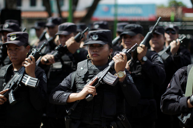 Members of the Territorial Intervention force, a combined army-police unit, participate in a ceremony prior to their deployment to deal with gang violence in violent areas in Apopa, El Salvador July 6, 2016. (Photo by Jose Cabezas/Reuters)