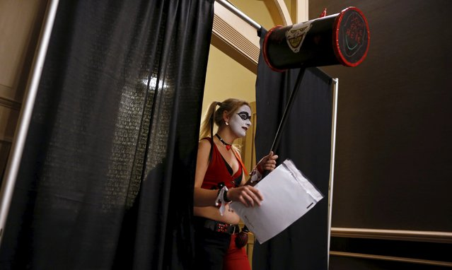 A contestant steps out from backstage after competing in the costume contest at Wizard World Comic Con in Chicago, Illinois, United States, August 22, 2015. (Photo by Jim Young/Reuters)