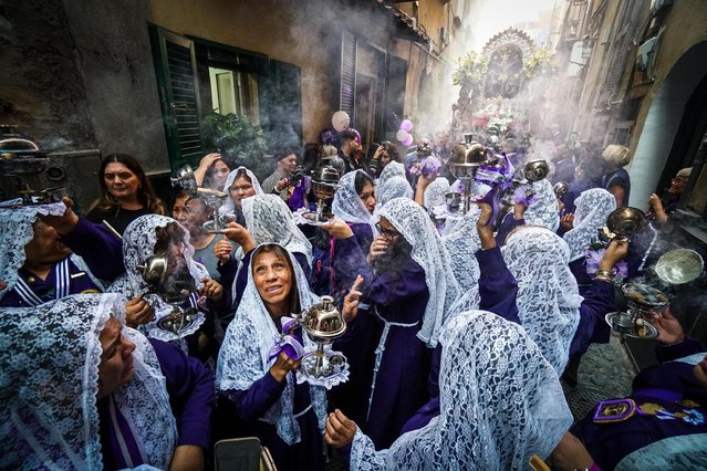 Peruvian women celebrate the feast of Senor de los Milagros (Lord of Miracles) in the alleys of the 'Quartieri Spagnoli' district, in Naples, Italy, 27 October 2019. Every year, in October, all the Peruvian communities of the world celebrate the depiction of the Christ of Lima who escaped from 1655 to countless earthquakes in the Peruvian capital, so as to retain that miraculous picture. (Photo by Cesare Abbate/EPA/EFE/Rex Features/Shutterstock)