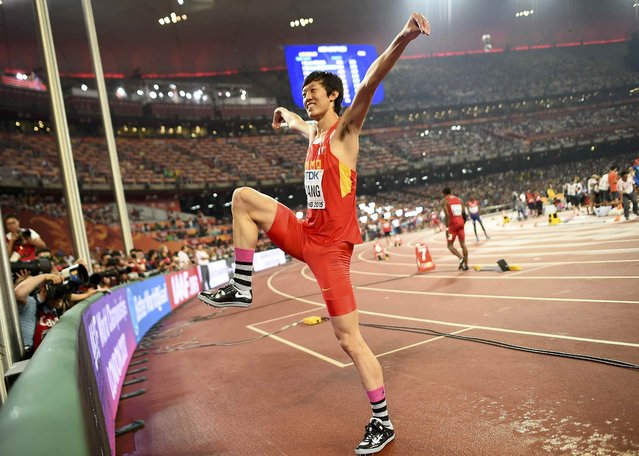 Second placed Zhang Guowei of China gestures as he celebrates after winning silver in the men's high jump final during the 15th IAAF World Championships at the National Stadium in Beijing, China, August 30, 2015. (Photo by Dylan Martinez/Reuters)
