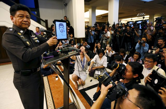 Thai police spokesman Prawut Thawornsiri shows a sketch of a suspect believed to be involved in the recent Bangkok blast at the Royal Thai Police headquarters in Bangkok, Thailand, September 1, 2015. Thai police have issued arrest warrants for three more foreign male suspects, Prawut said. (Photo by Chaiwat Subprasom/Reuters)