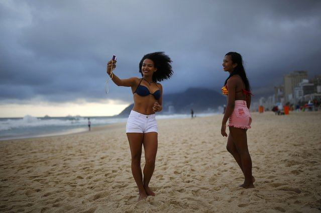 Women pose for a selfie at Ipanema Beach in Rio de Janeiro, Brazil on July 30, 2016. (Photo by Nacho Doce/Reuters)