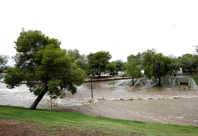 Floodwaters surge Monday, September 8, 2014, in Scottsdale, Ariz. The remnants of Hurricane Norbert pushed into the desert Southwest and swamped Arizona Monday, breaking the previous record for rainfall in a single day in Phoenix. (Photo by Rick Scuteri/AP Photo)