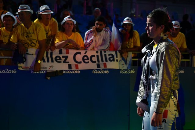 France's Cecilia Berder reacts after losing to Russia's Sofya Velikaya in their women's individual sabre quarter-final bout as part of the fencing event of the Rio 2016 Olympic Games, on August 8, 2016, at the Carioca Arena 3, in Rio de Janeiro. (Photo by Fabrice Coffrini/AFP Photo)