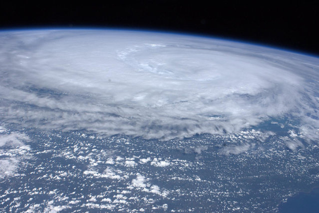 A photo taken by an Expedition 28 crew member aboard the International Space Station shows Hurricane Irene off the east coast of the United States on August 26, 2011. (Photo by Reuters/NASA)