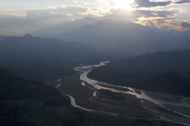 In this September 19, 2014 photo, the Ene river is seen from a military helicopter as it flies over the Apurimac, Ene and Mantaro River Valleys, or VRAEM, the world's No. 1 coca-growing region, in Pichari, Peru. (Photo by Rodrigo Abd/AP Photo)