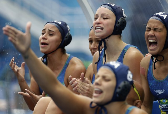 Brazil players yell toward their teammates during a preliminary women's water polo match against Russia at the Summer Olympics in Rio de Janeiro, Brazil, Thursday, August 11, 2016. (Photo by Sergei Grits/AP Photo)