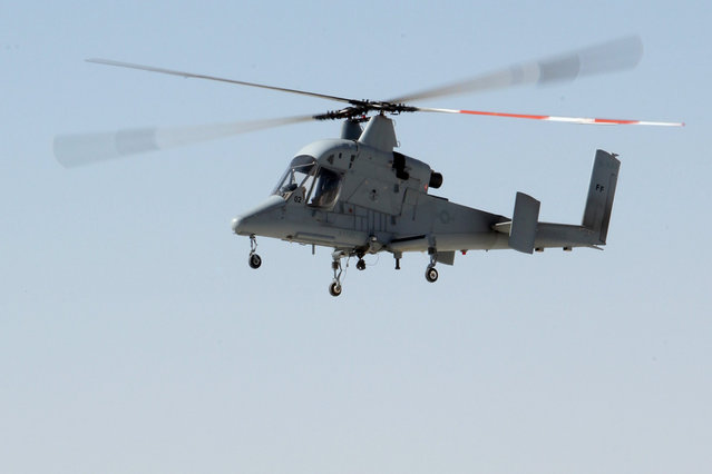 A Kaman K-MAX helicopter, part of a U.S. Marine Corps Cargo Resupply Unmanned Aircraft System (CRUAS) lands at Camp Bastion, Helmand Province, Afghanistan, on October 13, 2012. (Photo by Sgt. Keonaona C. Paulo/USMC)