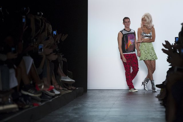 Designer Jeremy Scott comes to the runway with model Gigi Hadid to acknowledge attendees after presenting his Spring/Summer 2016 collection during New York Fashion Week in New York, September 14, 2015. (Photo by Andrew Kelly/Reuters)