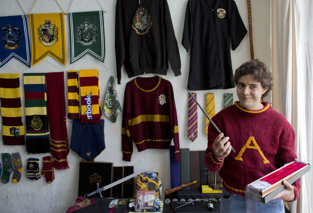 Menahem Asher Silva Vargas a 37 year old lawyer, displays a favorite wand, as he shows off his collection of Harry Potter memorabilia after being awarded the Guinness World Record title for the largest collection, in Mexico City, Monday, September 29, 2014. (Photo by Rebecca Blackwell/AP Photo)