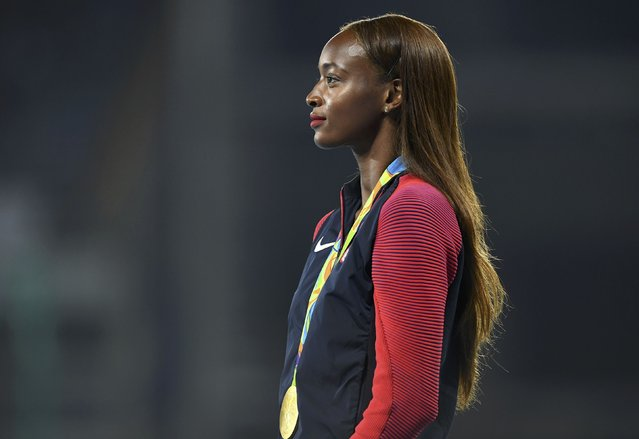 2016 Rio Olympics, Athletics, Victory Ceremony, Women's 400m Hurdles Victory Ceremony, Olympic Stadium, Rio de Janeiro, Brazil on August 19, 2016. Dalilah Muhammad (USA) of USA poses with her gold medal. (Photo by Dylan Martinez/Reuters)