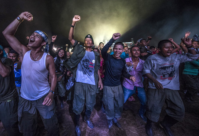 Members of the Revolutionary Armed Forces of Colombia (FARC) guerrilla dance during a cultural event held at their encampment in Llanos del Yari, Caqueta department, Colombia, on September 21, 2016. After 52 years of armed conflict, FARC rebels open what leaders hope will be their last conference as a guerrilla army, where they are due to vote on a historic peace deal with the Colombian government. (Photo by Luis Acosta/AFP Photo)