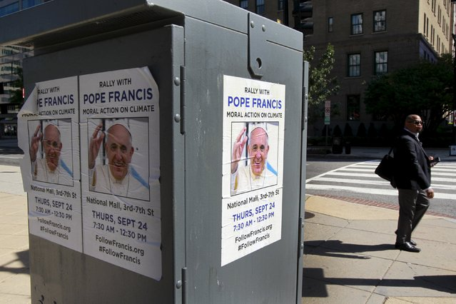A man walks past greetings for Pope Francis near the White House in Washington September 23, 2015. (Photo by Yuri Gripas/Reuters)