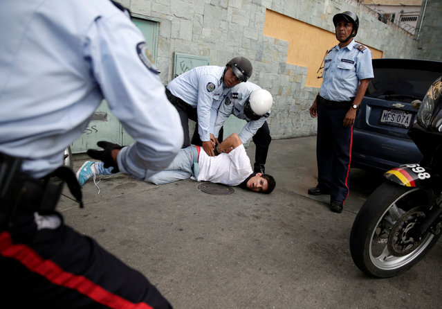 A protester (C) is detained during a rally to demand for a referendum to remove Venezuela's President Nicolas Maduro in Caracas, Venezuela, September 1, 2016. (Photo by Marco Bello/Reuters)