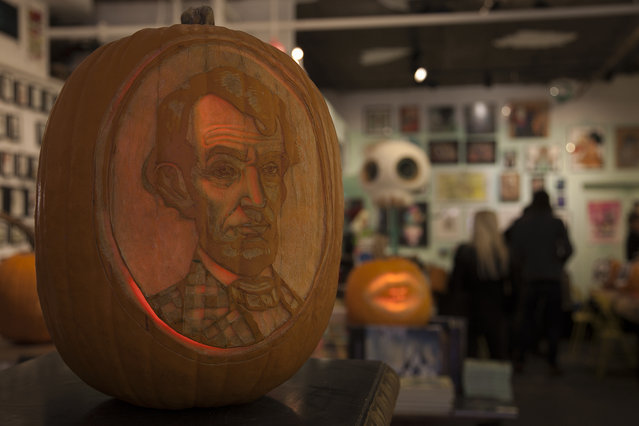 A Mark Ryden pumpkin created by the Maniac Pumpkin Carvers at Cotton Candy Machine in Brooklyn, N.Y. on October 18, 2014. (Photo by Siemond Chan/Yahoo Finance)