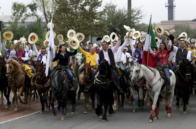 Jaime Rodriguez (C) rides on his horse, accompanied by supporters at Fundidora park, after taking the oath on Saturday as the new governor of the Nuevo Leon state in Monterrey, Mexico October 4, 2015. Rodriguez, a former member of President Enrique Pena Nieto's Institutional Revolutionary Party (PRI), is the first independent candidate to win a state governorship in modern Mexico. (Photo by Daniel Becerril/Reuters)