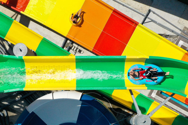 A drone photo shows an aerial view of  people enjoying rides on water slides at an aquapark in Istanbul, Turkey on August 16, 2020. (Photo by Muhammed Enes Yildirim/Anadolu Agency via Getty Images)