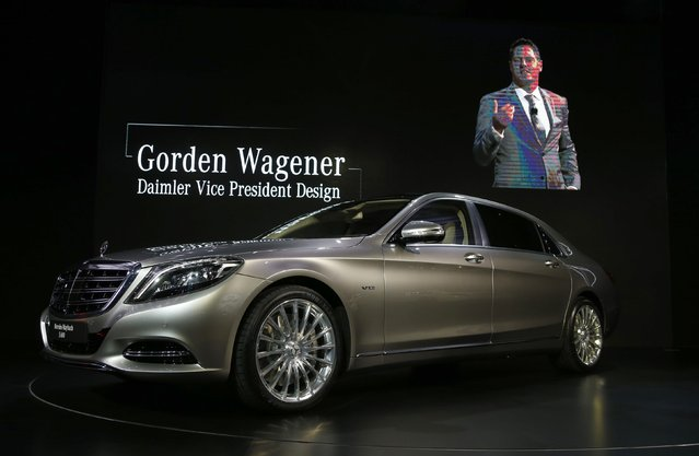 Gorden Wagener, Daimler vice president of design, is shown on screen speaking about the Mercedes-Maybach S-Class during the model's world debut at the Los Angeles Auto Show in Los Angeles, California November 19, 2014. (Photo by Lucy Nicholson/Reuters)