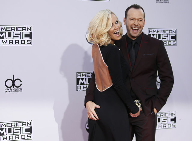 Actress Jenny McCarthy and husband, Donnie Wahlberg arrive at the 42nd American Music Awards in Los Angeles. (Photo by Danny Moloshok/Reuters)