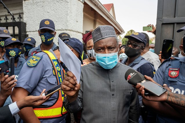 """The Nigerian Ambassador for South Africa Kabiru Bala (C) stands in front of the Nigerian Embassy where protestors gathered during a march under the banner of """"#Put South Africans First"""" in Pretoria on September 23, 2020. (Photo by Luca Sola/AFP Photo)"""