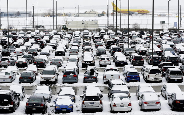 Snow covers the cars parked in the parking lots at O'Hare International Airport in Chicago, Wednesday, February 27, 2013. The storm that socked the Chicago area with the season's biggest snowfall has tapered off, but it's not completely finished. Snow will continue falling periodically today, dropping another inch or two in the city and up to three inches in the northern suburbs, according to the National Weather Service. (Photo by Nam Y. Huh/AP Photo)