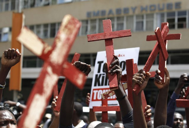 Protesters hold up wooden crosses, symbolising people killed in a series of attacks, during the #OccupyHarambeeAve protest in Kenya's capital Nairobi November 25, 2014. (Photo by Thomas Mukoya/Reuters)