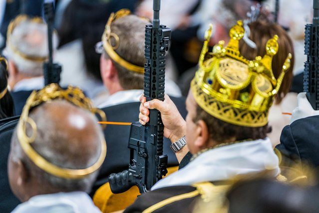 Parishioners with the Sanctuary Church hold onto their AR-15s, which churchgoers were encouraged to bring to a blessing ceremony to rededicate their marriages, at the World Peace and Unification Sanctuary in Newfoundland, Pennsylvania, USA, 28 February 2018. (Photo by Jim Lo Scalzo/EPA/EFE)
