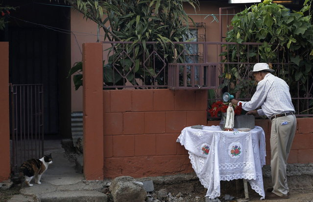A man prepares an altar outside his house before a Holy Week procession in Tapachula, near San Jose, March 27, 2013. Holy Week is celebrated in many Christian traditions during the week before Easter. (Photo by Juan Carlos Ulate/Reuters)