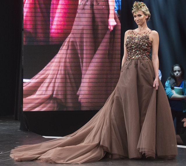 Former professional tennis player Tatiana Golovin presents a chocolate studded dress during a show as part of the chocolate fair in Paris, Tuesday, October 27, 2015. (Photo by Jacques Brinon/AP Photo)
