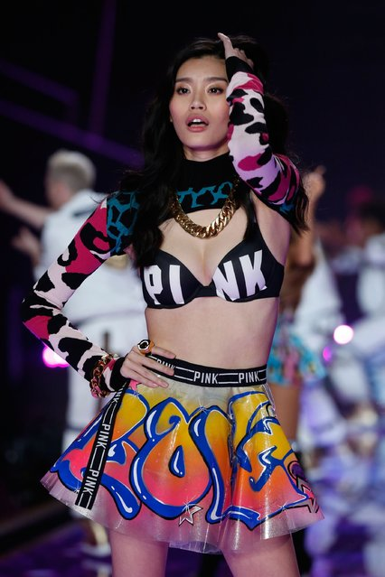 Ming Xi on the runway at the 2014 Victoria's Secret Runway Show – Swarovski Crystal Looks at Earl's Court Exhibition Centre on December 2, 2014 in London, England. (Photo by Tristan Fewings/Getty Images for Swarovski)