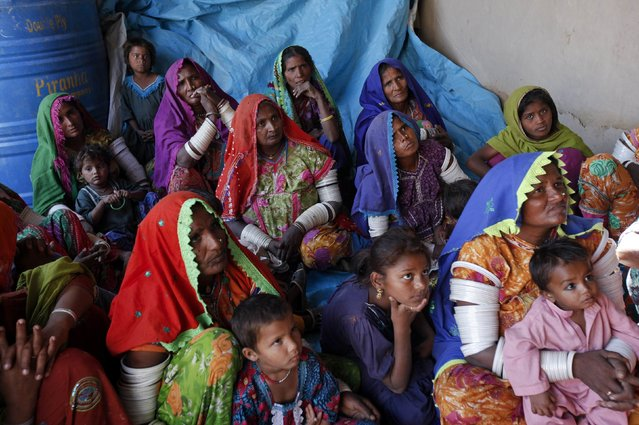 Women cotton pickers sit and listen during a leadership and advocacy skills workshop organized by the Sindh Community Foundation (SCF), in Meeran Pur village, north of Karachi November 23, 2014. (Photo by Akhtar Soomro/Reuters)