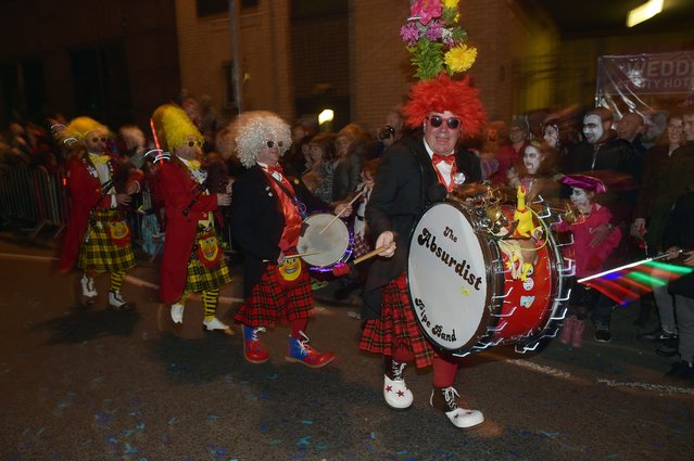 Performers make their way along the parade route as over 30,000 people take part in Europe's largest Halloween street parade on October 31, 2015 in Londonderry, Northern Ireland. Derry has established itself as the number one Halloween destination in the world according to a recent poll with visitors and enthusiasts taking part in the week long City of Bones festivities. (Photo by Charles McQuillan/Getty Images)
