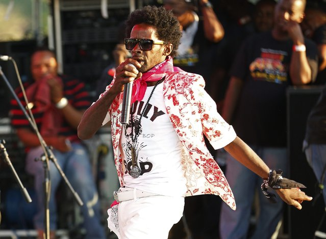 Jamaican dancehall artist Gully Bop performs at the Sting 2014 concert in Kingston, December 27, 2014. (Photo by Gilbert Bellamy/Reuters)
