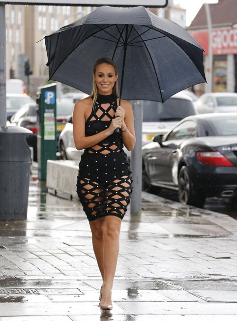 Picture shows: Amber Dowding. TOWIE cast members arrive for filming their reality series at Faces nightclub in Gants Hill, Essex, England on October 16, 2016. It was raining down as the cast members arrived but that didn't stop them from smiling and posing for the cameras. (Photo by FameFlynet UK)